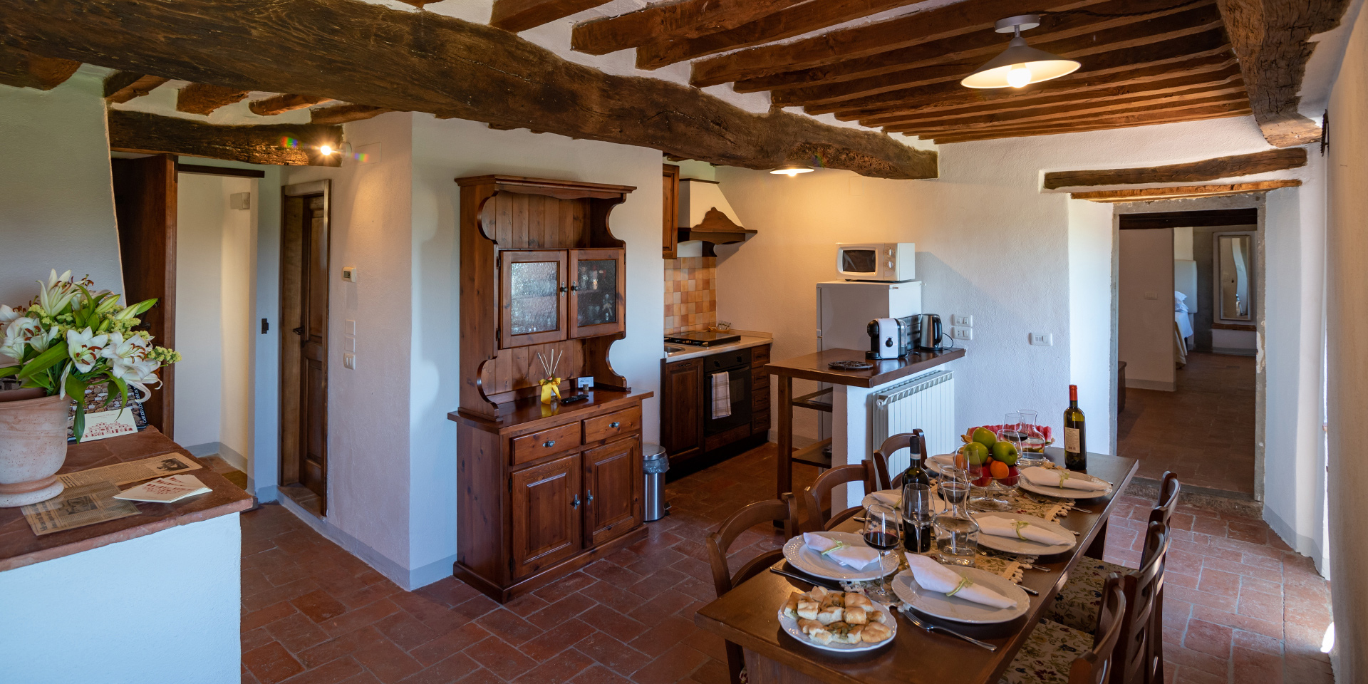 Living room and kitchen in Saena Apartment, Monastero San Silvestro
